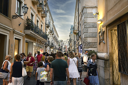 a crowd of tourists strolling along