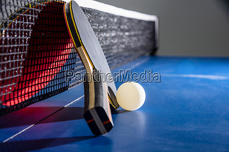 closeup red table tennis paddle white