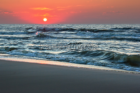 sunset over rough seas