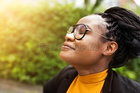 african woman breathing clean air