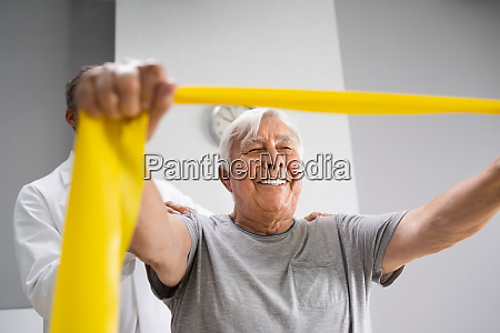 physical therapy patient using physiotherapy bands