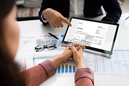 accountant checking business invoice or bill