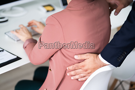 sexual harassment at workplace touching woman