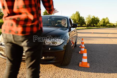 student passes between cones driving school