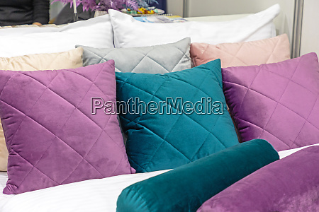 colourful pillows in bed