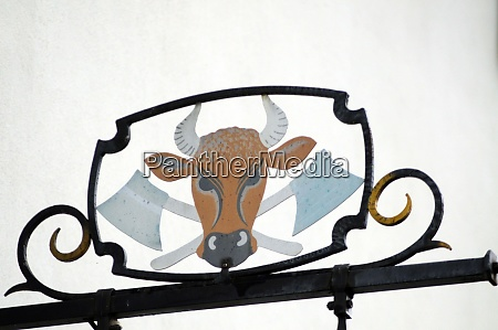 butcher shop sign with the head