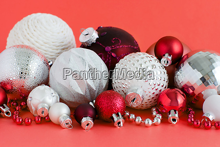 christmas baubles on a red