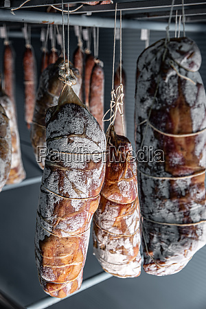 salami hanging in the warehouse