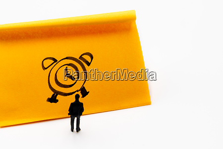 miniature figurine posed as businessman in