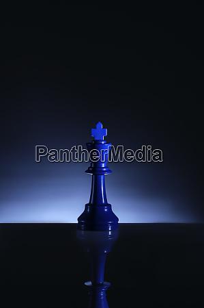 studio shot of blue chess king