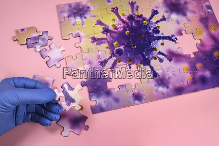 studio shot of puzzle with coronavirus