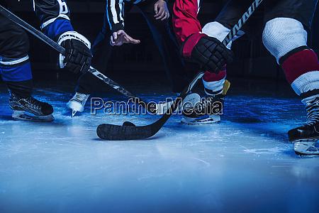 hockey players and referee starting match