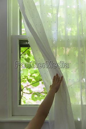 girl 6 7 opening curtain