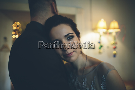 romantic couple embracing on date in