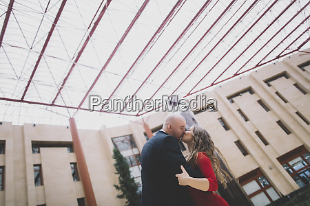 newlywed couple kissing after ceremony