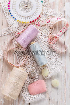 assortment of sewing accessories on white