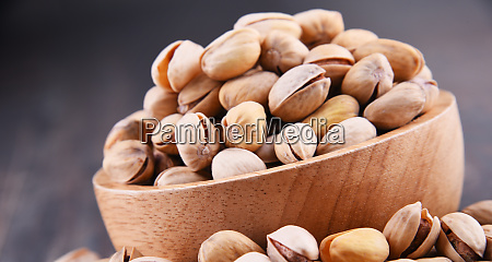 composition with bowl of pistachio on