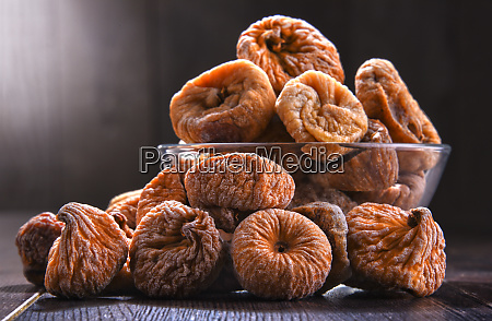 composition with bowl of dried figs
