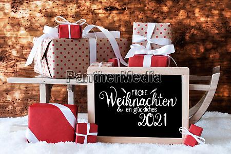 sleigh gift snow bokeh glueckliches 2021