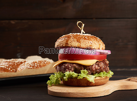 cheeseburger with tomatoes barbecue cutlet and