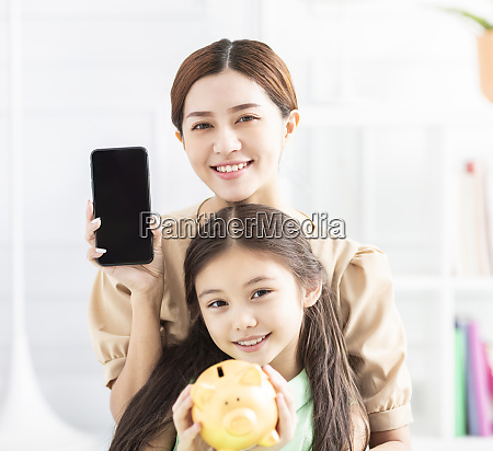 happy mother and daughter showing the
