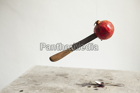 floating knife in pomegranate