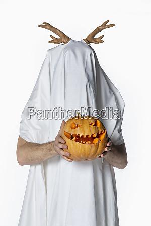 portrait playful man in sheet costume