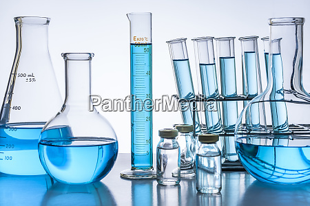laboratory glassware with blue liquid
