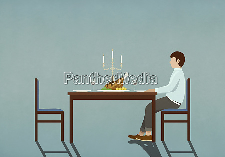 man waiting at table with candlelight