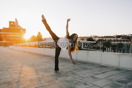 playful young female dancer doing standing