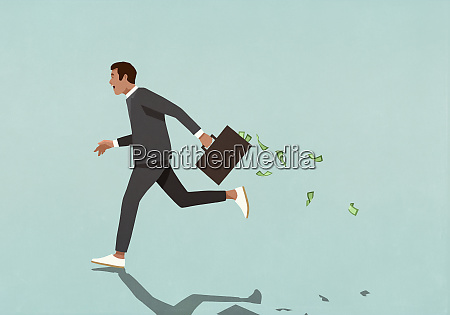 businessman running with briefcase full of