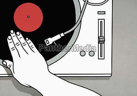dj spinning vinyl record on turntable