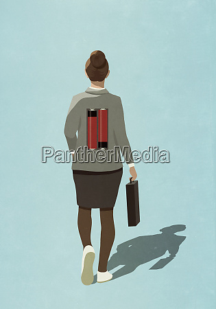 batteries on back of businesswoman