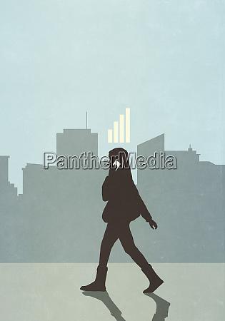 cellular reception bars above businesswoman walking
