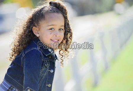 portrait smiling girl in denim jacket
