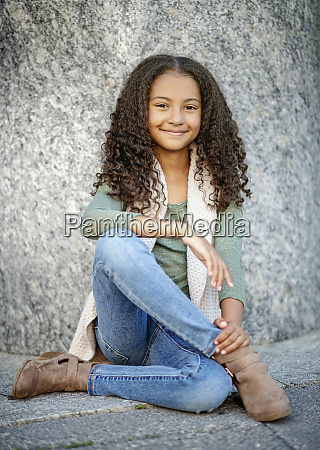 portrait confident girl with curly hair