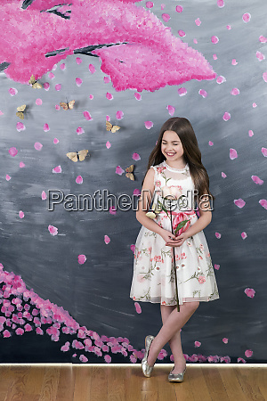portrait smiling girl in dress with
