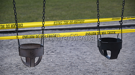 playground swings taped off during covid
