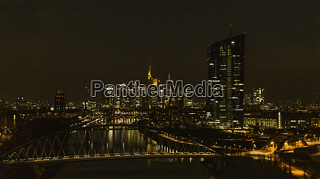 illuminated cityscape along river at night