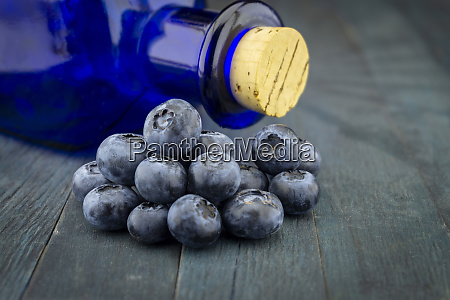 fresh blueberries and corked pharmacy bottle