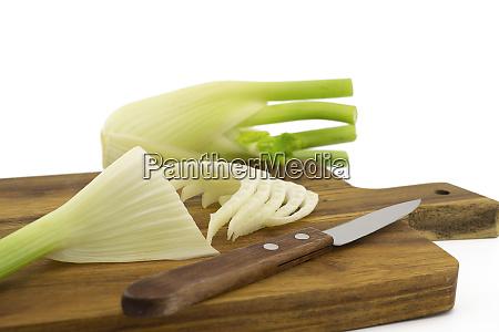 preparing fresh fennel on wooden cutting