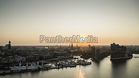 sunset over tranquil hamburg cityscape and