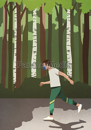 man with protective face mask jogging