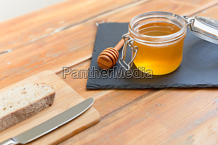 organic honey and rustic bread on