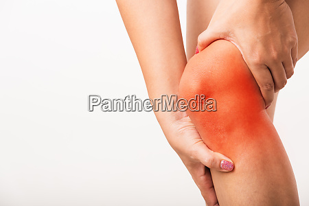 woman holding her painful knee