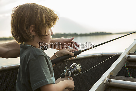 a five year old boy fishing