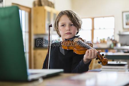 six year old boy playing violin