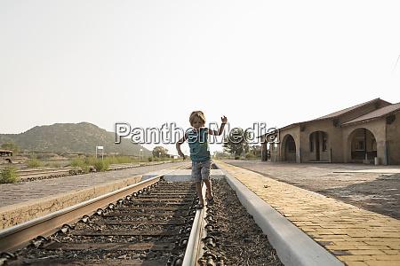 4 year old boy balancing on