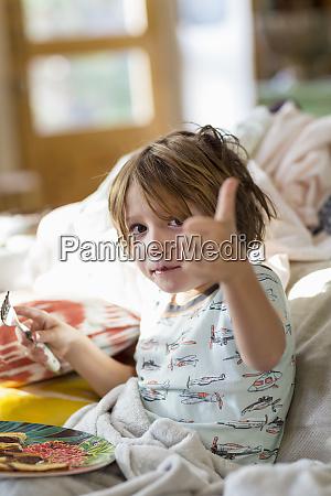 4 year old boy eating pancakes