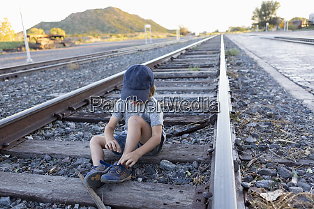 4 year old boy on railroad